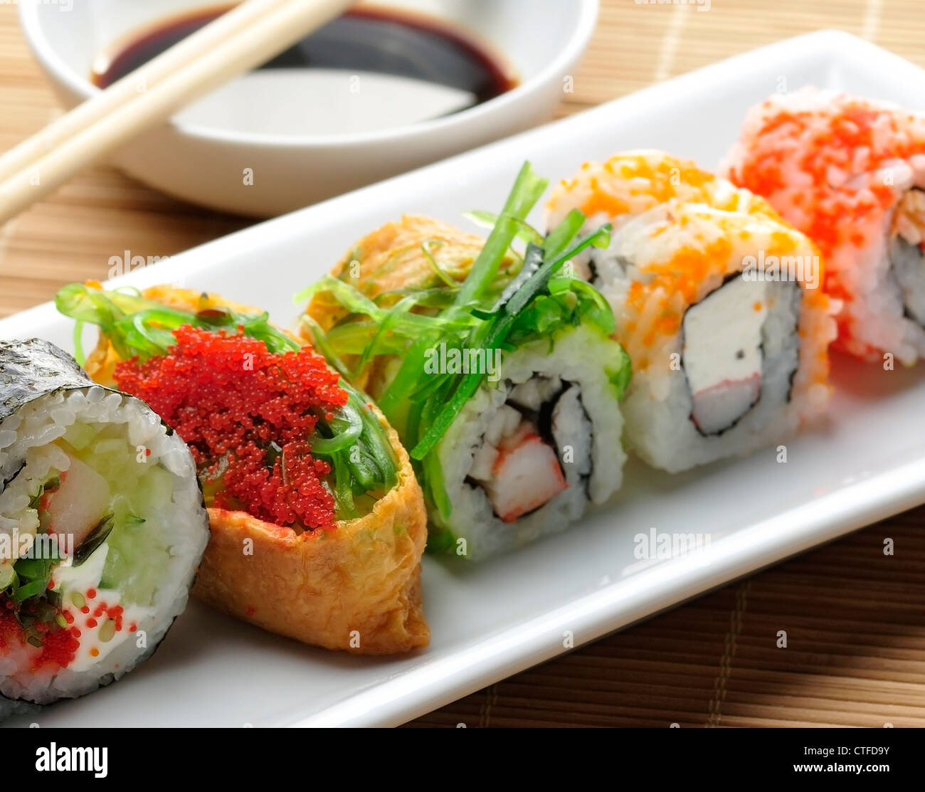 Sushi Assortment On White Dish, close up - Stock Image