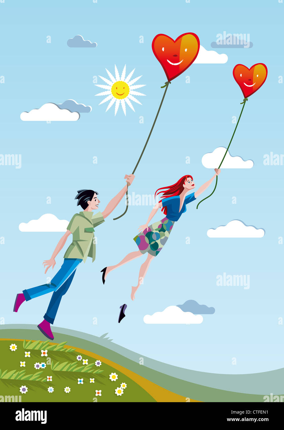 A man and a woman towering over the fields holding a heart tied with strings. - Stock Image