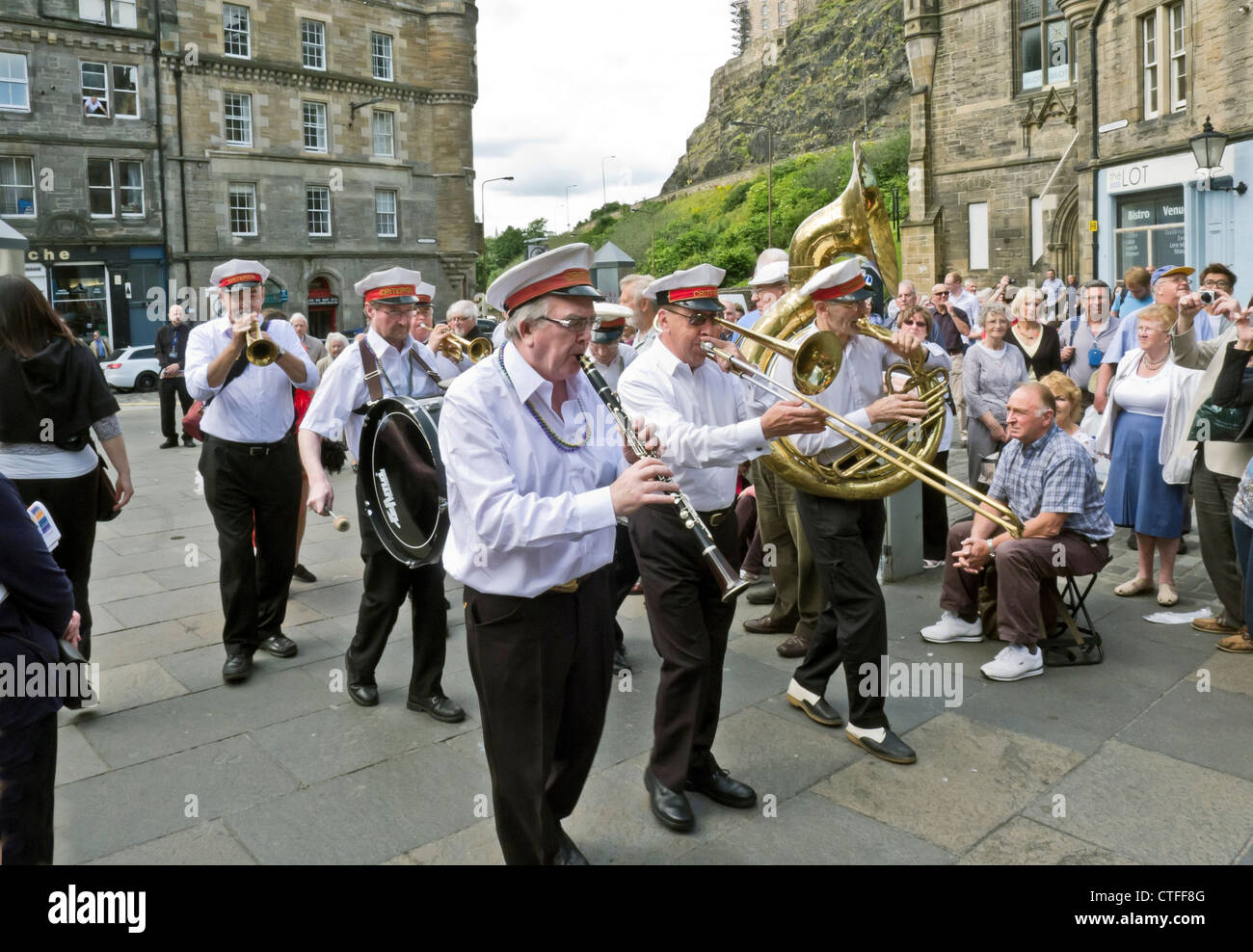 The Criterion Brass band plays in the Grassmarket at the opening of the Edinburgh Jazz and Blues Festival in Edinburgh - Stock Image