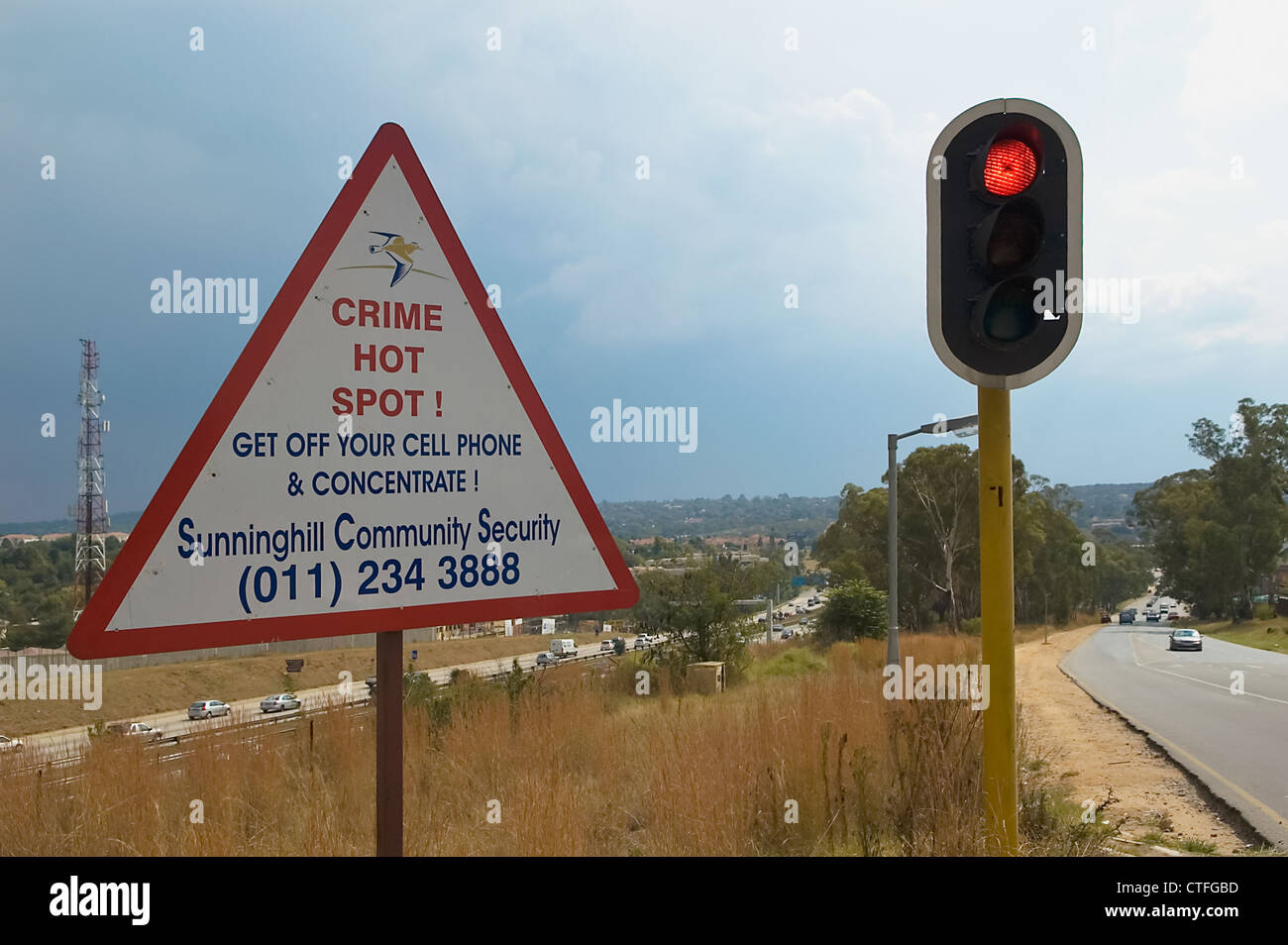 Sign warning of crime hot spot in Johannesburg - Stock Image