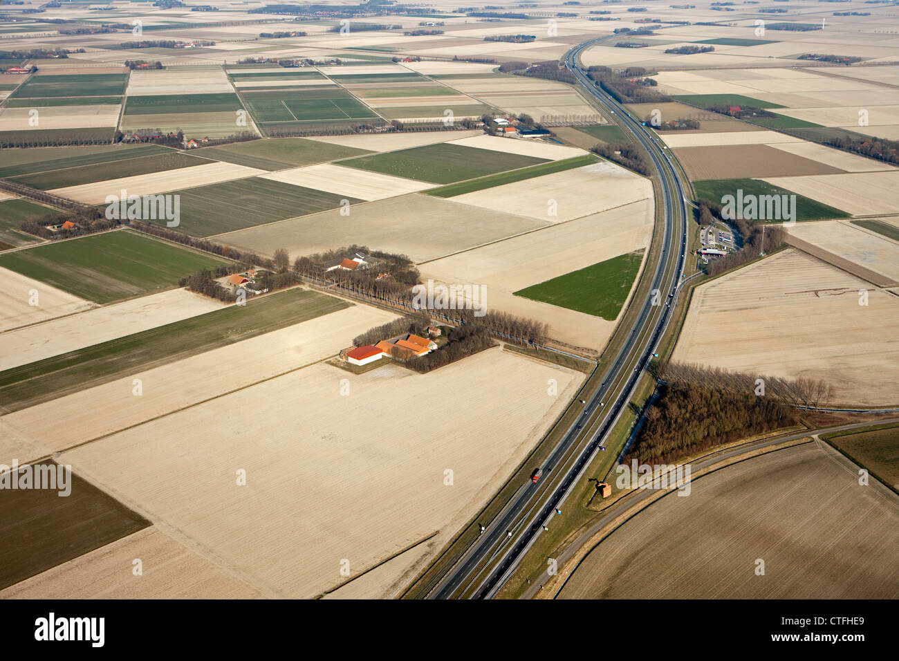 The Netherlands, Nagele, Farms and farmland in Flevopolder. Highway A6. Aerial. - Stock Image