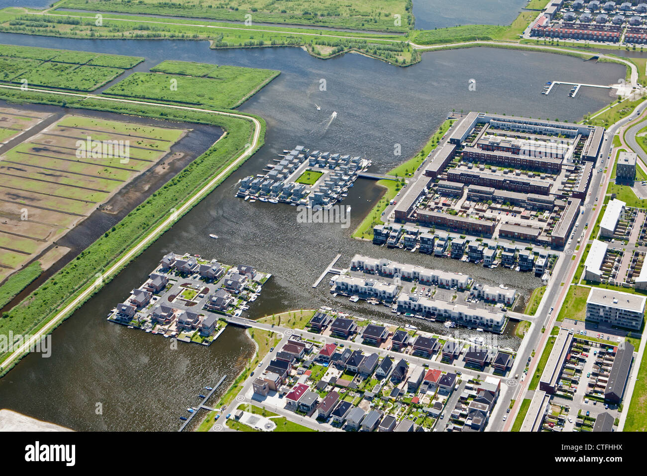The Netherlands, Almere, Residential areas. Aerial. - Stock Image