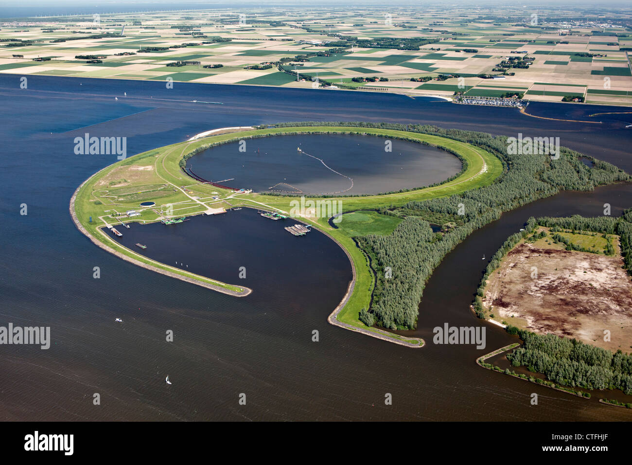 The Ijsseloog is an artificial island in the lake called Ketelmeer used as a deposit of silt pollution. Aerial. - Stock Image