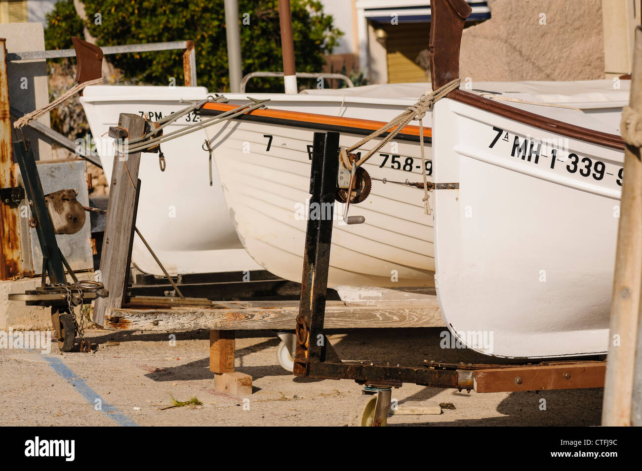 Small Spanish fishing boats tied up on land - Stock Image