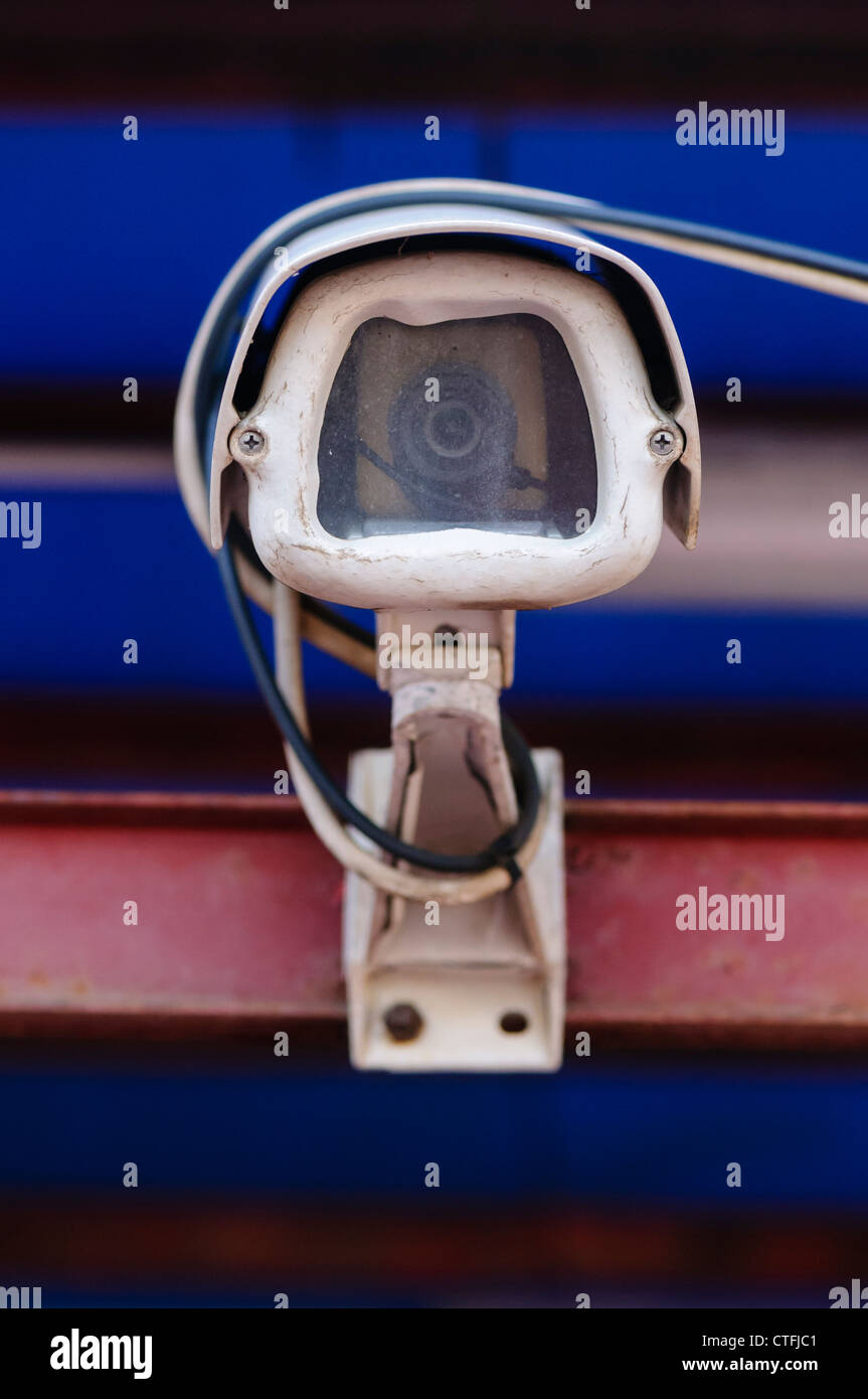 CCTV camera outside a closed down business - Stock Image