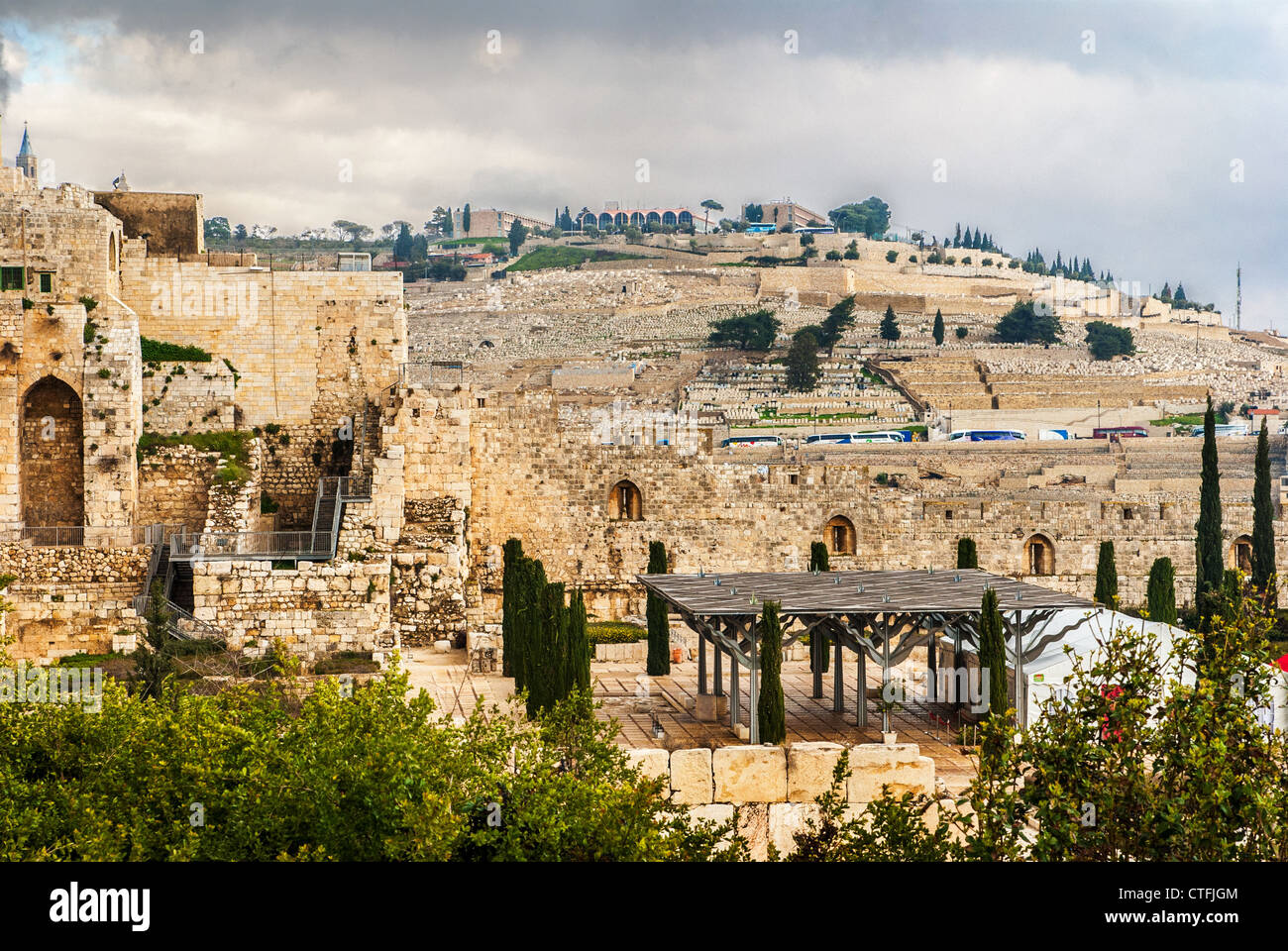 Rebuilt ruins outside the old city wall of Jerusalem, Israel with the Mount of Olives in the background. Stock Photo