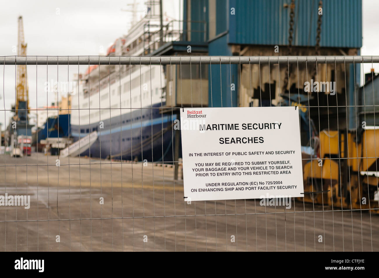 Security sign at the Port of Belfast warning about security searches - Stock Image