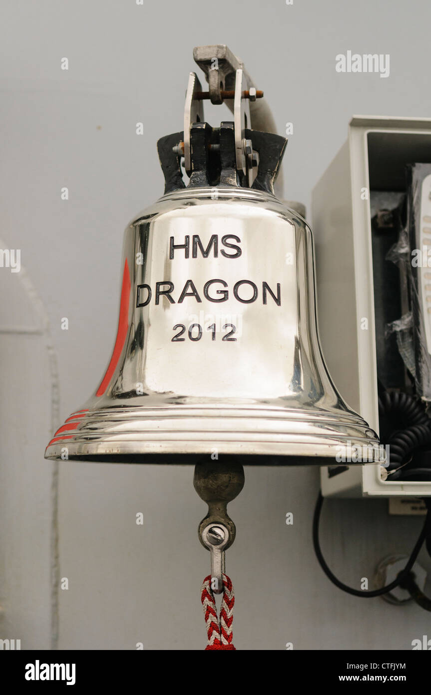 Ship's bell on Royal Navy Type 45 destroyer HMS Dragon - Stock Image