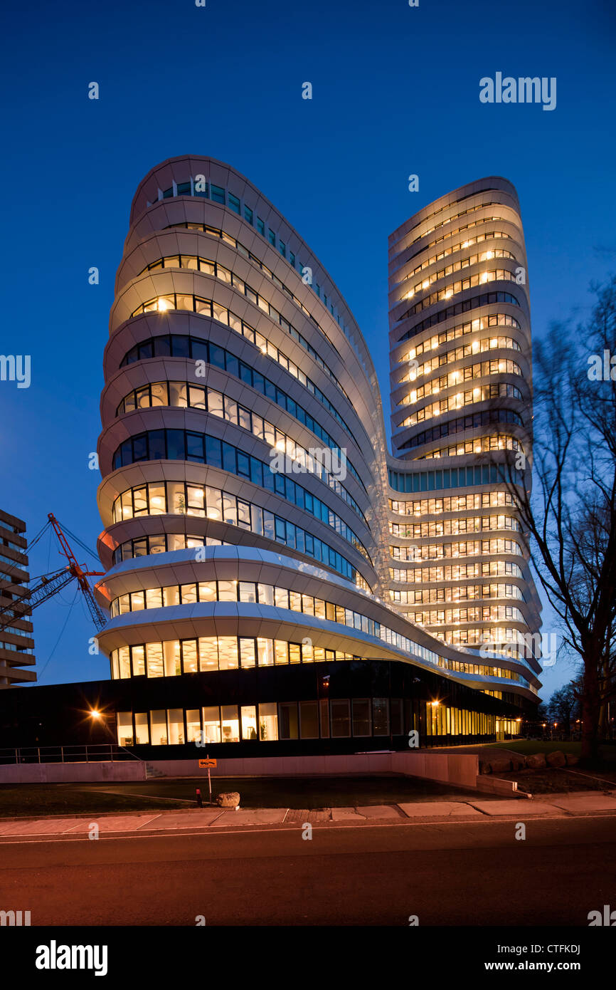 The Netherlands, Groningen, Office building for the education executive agency and tax offices. Dusk. - Stock Image