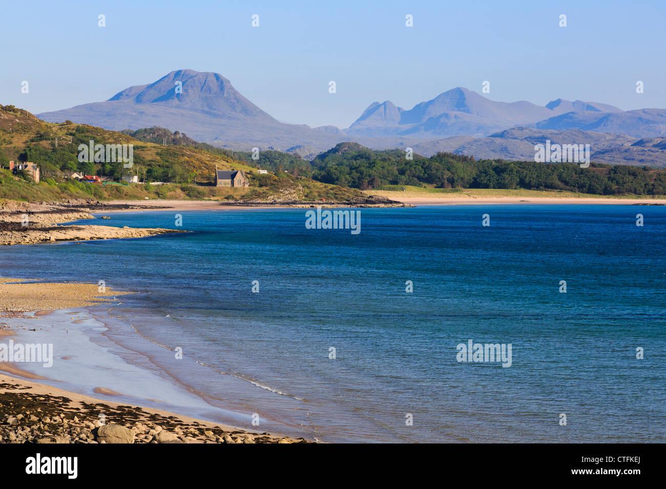 stunning view across Strath Bay in Loch Gairloch on northwest Scottish Highlands coast to Torridon mountains. Wester - Stock Image
