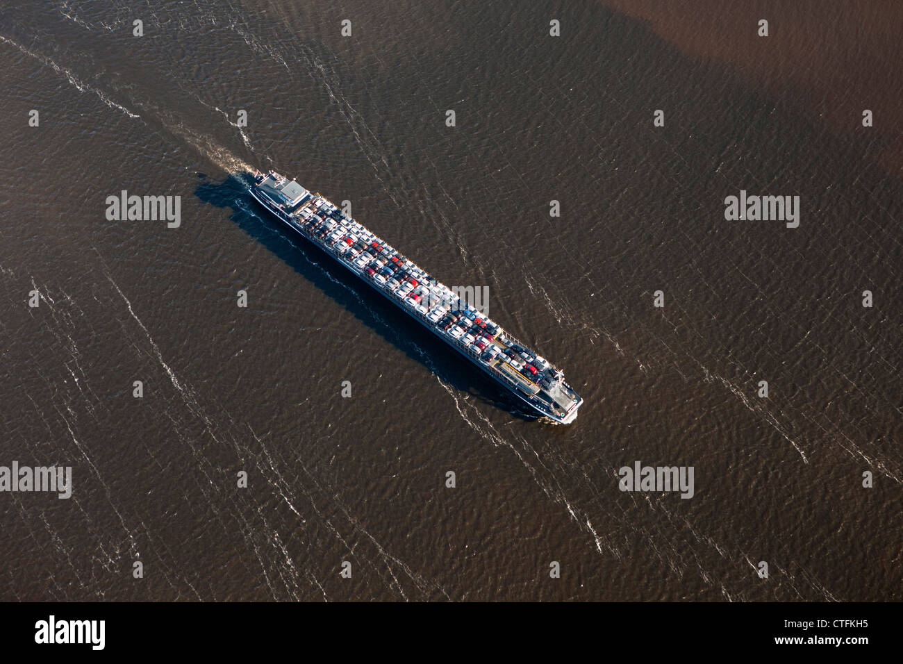 The Netherlands, Willemstad, River-vessel transporting cars. Aerial. - Stock Image