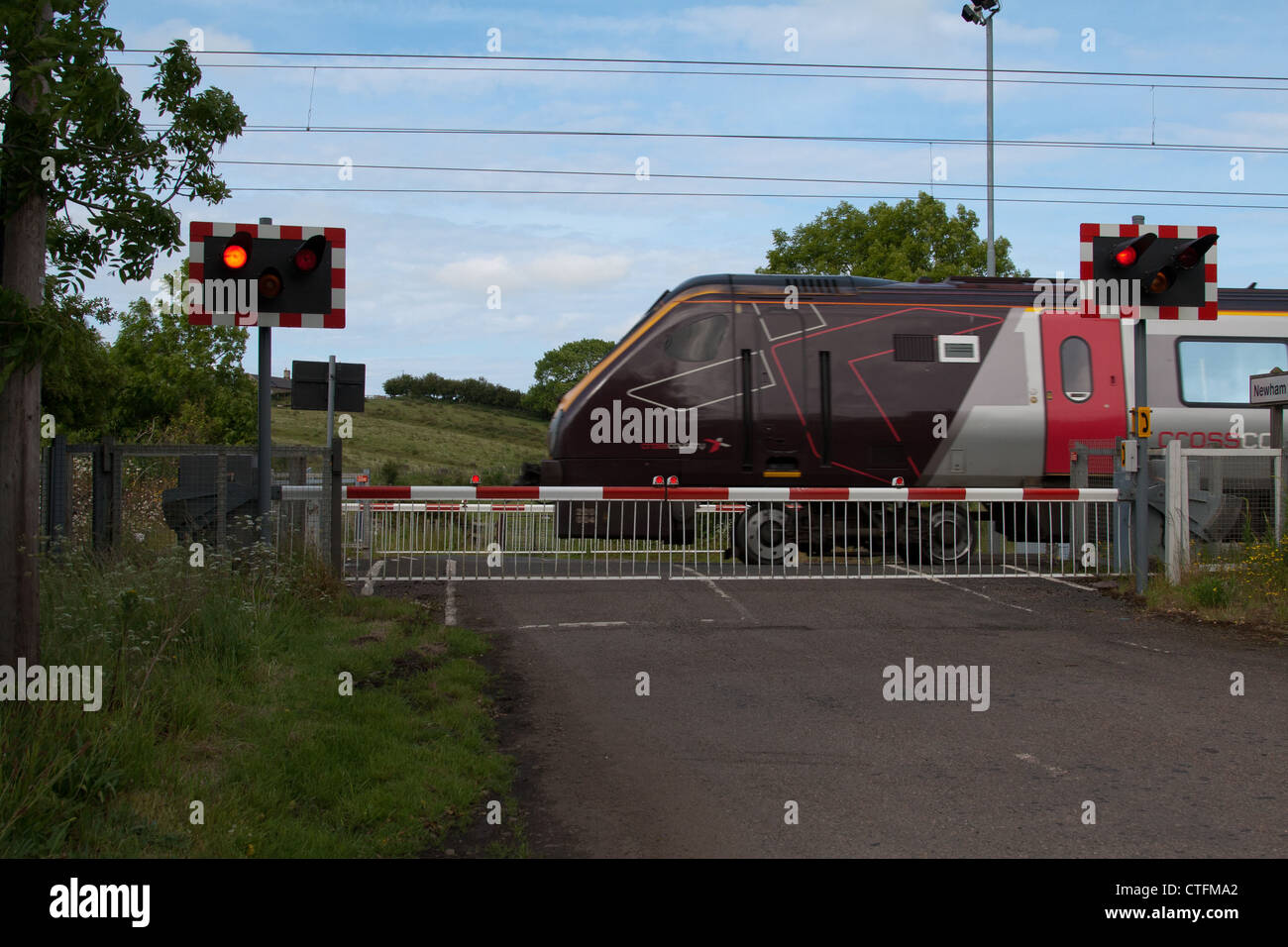 Front of Cross Country Train at Level Crossing on the East Coast Mainline in North East England - Stock Image