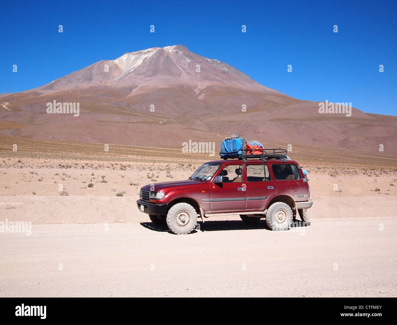Four-wheel drive tourist vehicle used for a multiple day tourist tour in the Atacama desert in Bolivia in front - Stock Image