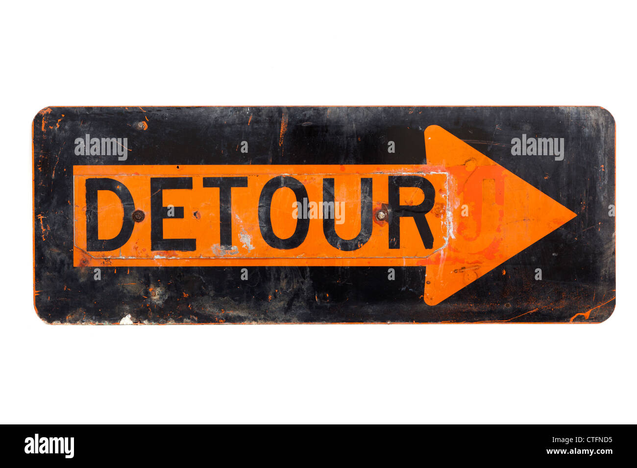 A very old, orange and black detour sign on a white background - Stock Image