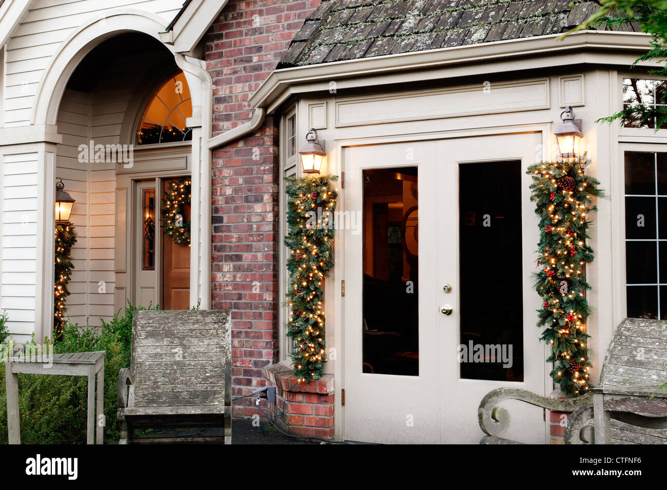 Outdoor Christmas Decorations On French Doors Porch Stock Photo