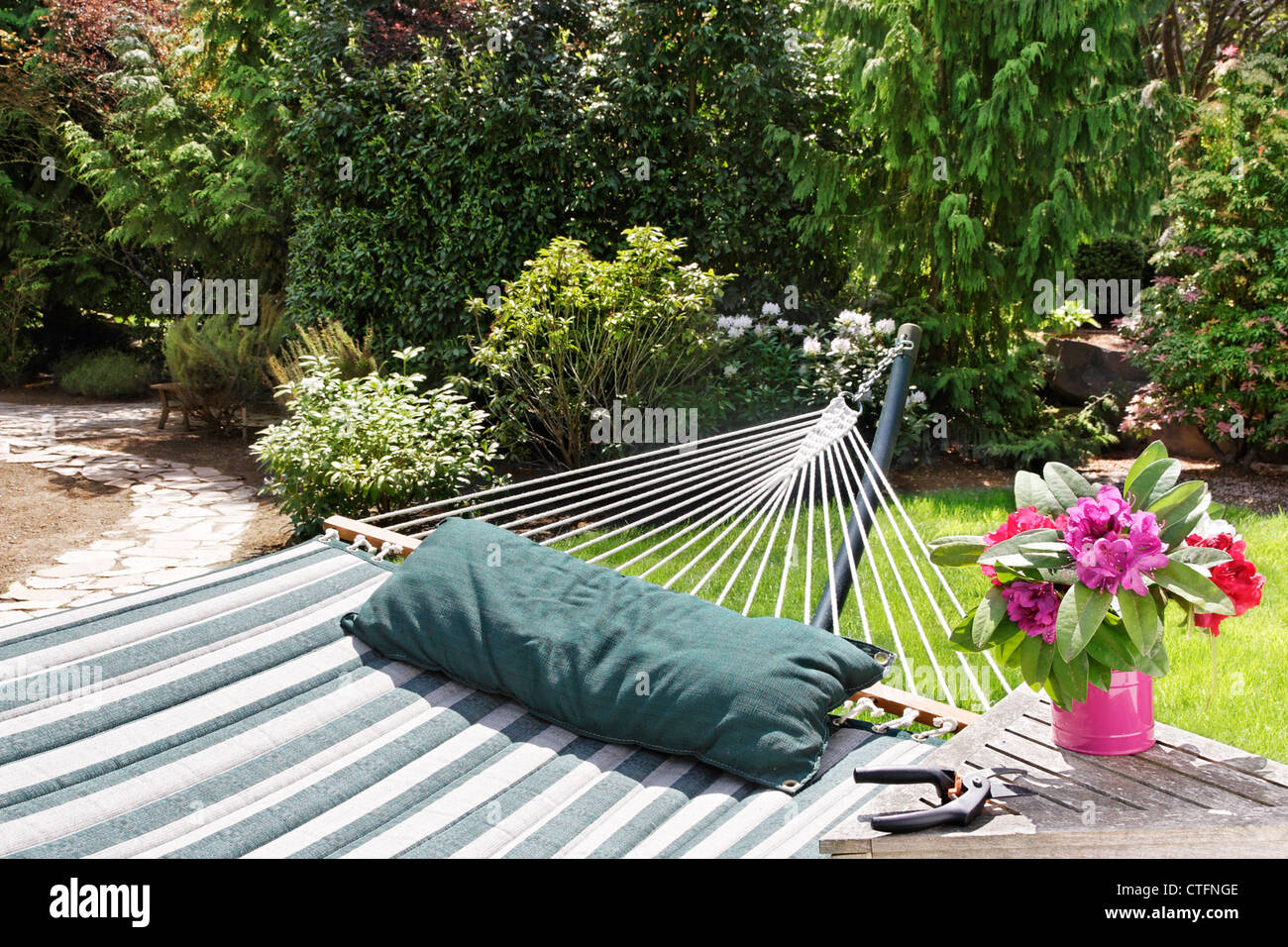 Relax And Enjoy The Garden After Cutting Some Flowers   Stock Image