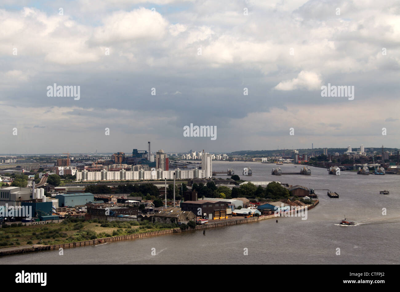 Aerial View of Silvertown and River Thames Flood Control from Emirates Air Line Cable Car - Stock Image