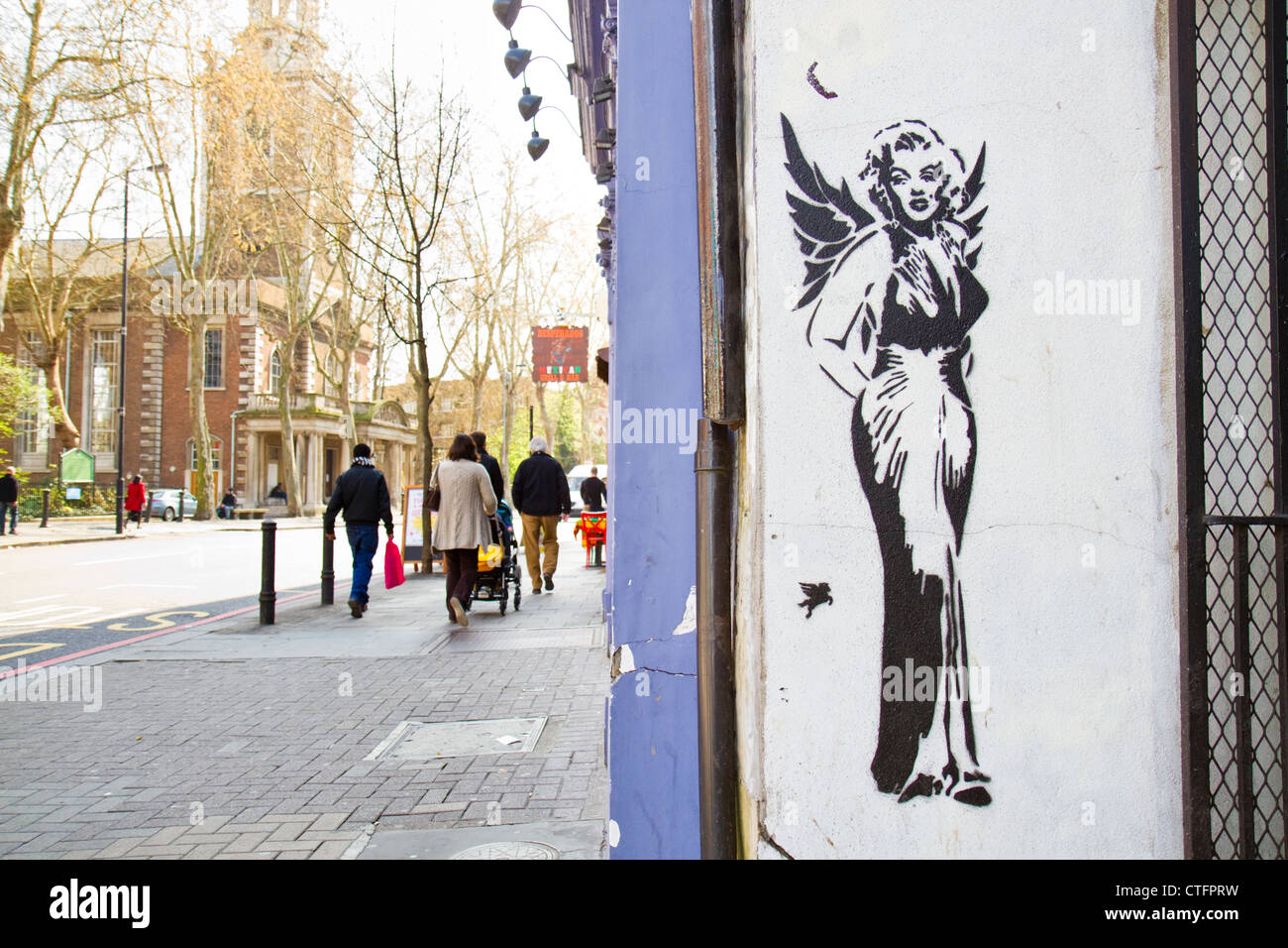 Spray paint stencil by graffiti artist Pegasus in Islington, London depicting Marilyn Monroe with angel wings - Stock Image