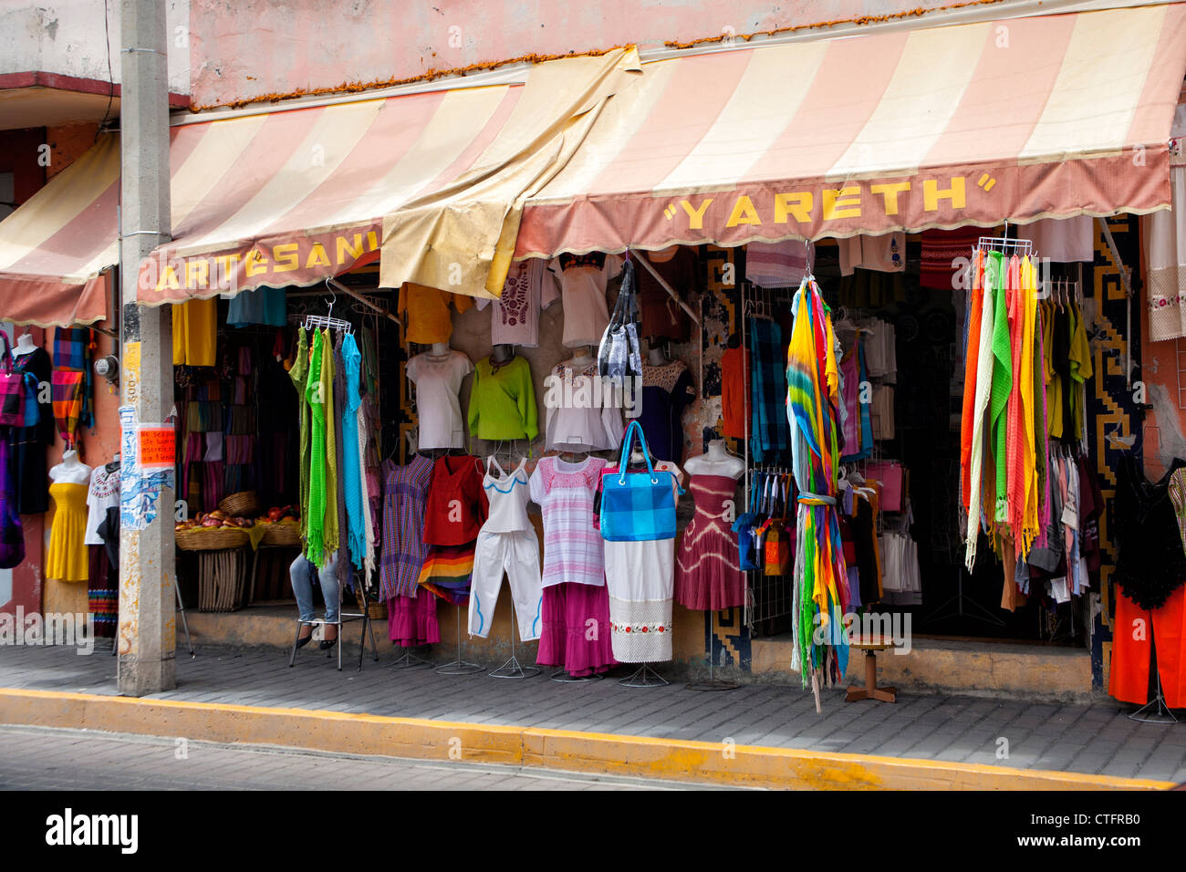 Colorful clothing in shop in Cholula, Mexico - Stock Image