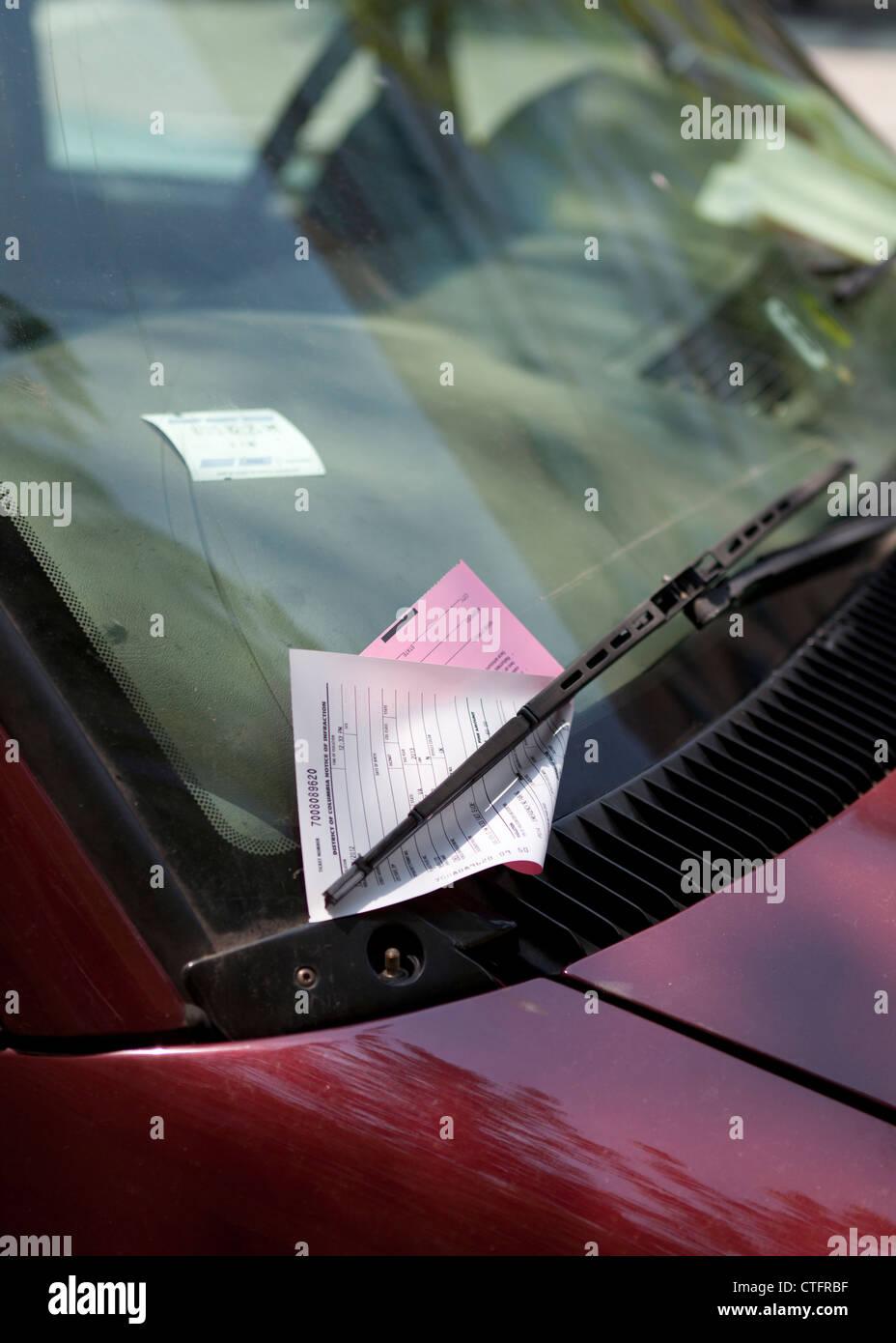 Parking ticket on windshield - Washington, DC USA - Stock Image