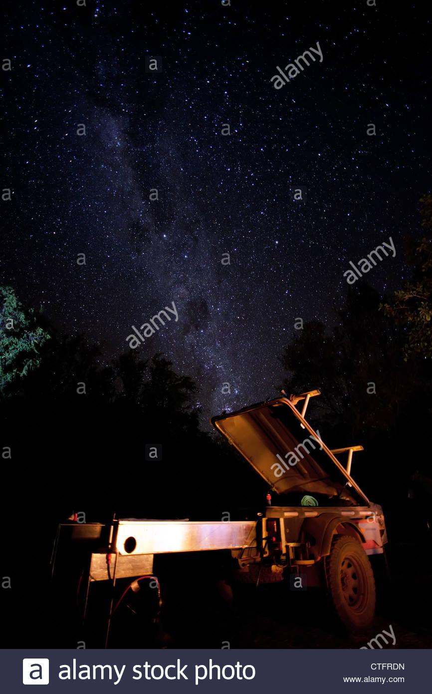A stockman pod trailer open beneath the milky way, at a campsite in Western Australia's Bungle Bungle ranges. - Stock Image