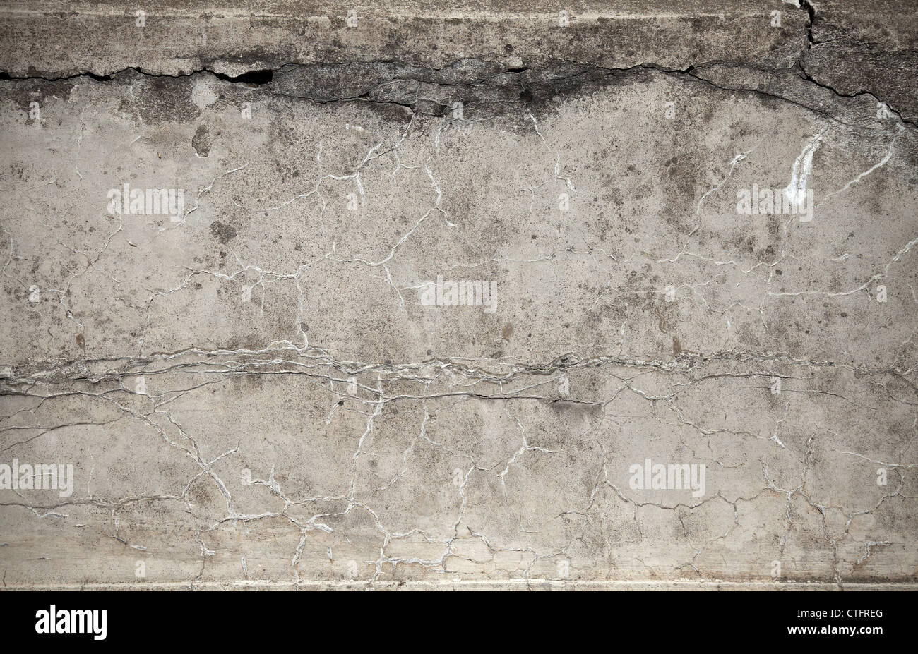 Closeup old weathered concrete wall texture with plaster - Stock Image