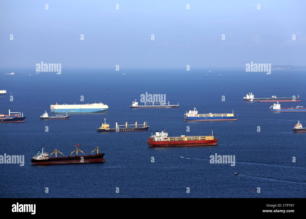 Ships anchored in Singapore Strait waiting for loading and unloading of cargo. - Stock Image