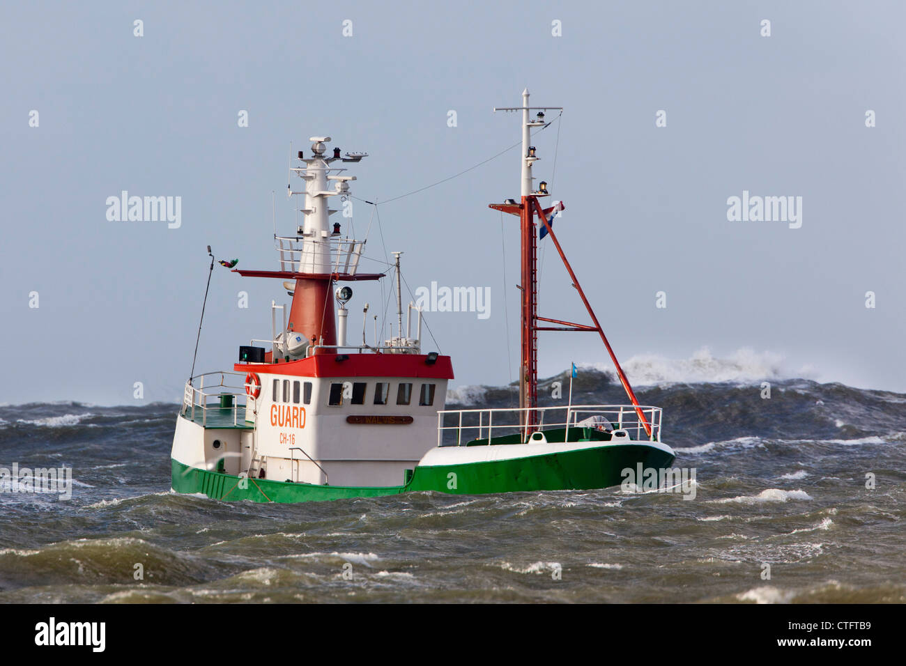 The Netherlands, IJmuiden, Storm. Boat in rough sea. Stock Photo
