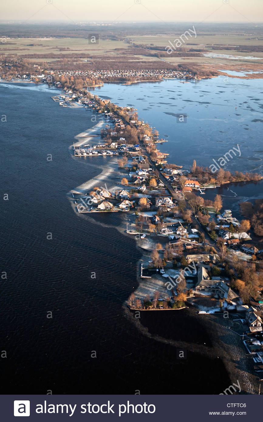 The Netherlands, Loosdrecht, Aerial. Houses near lake called Loosdrechtse Plassen. Winter. Frost. - Stock Image