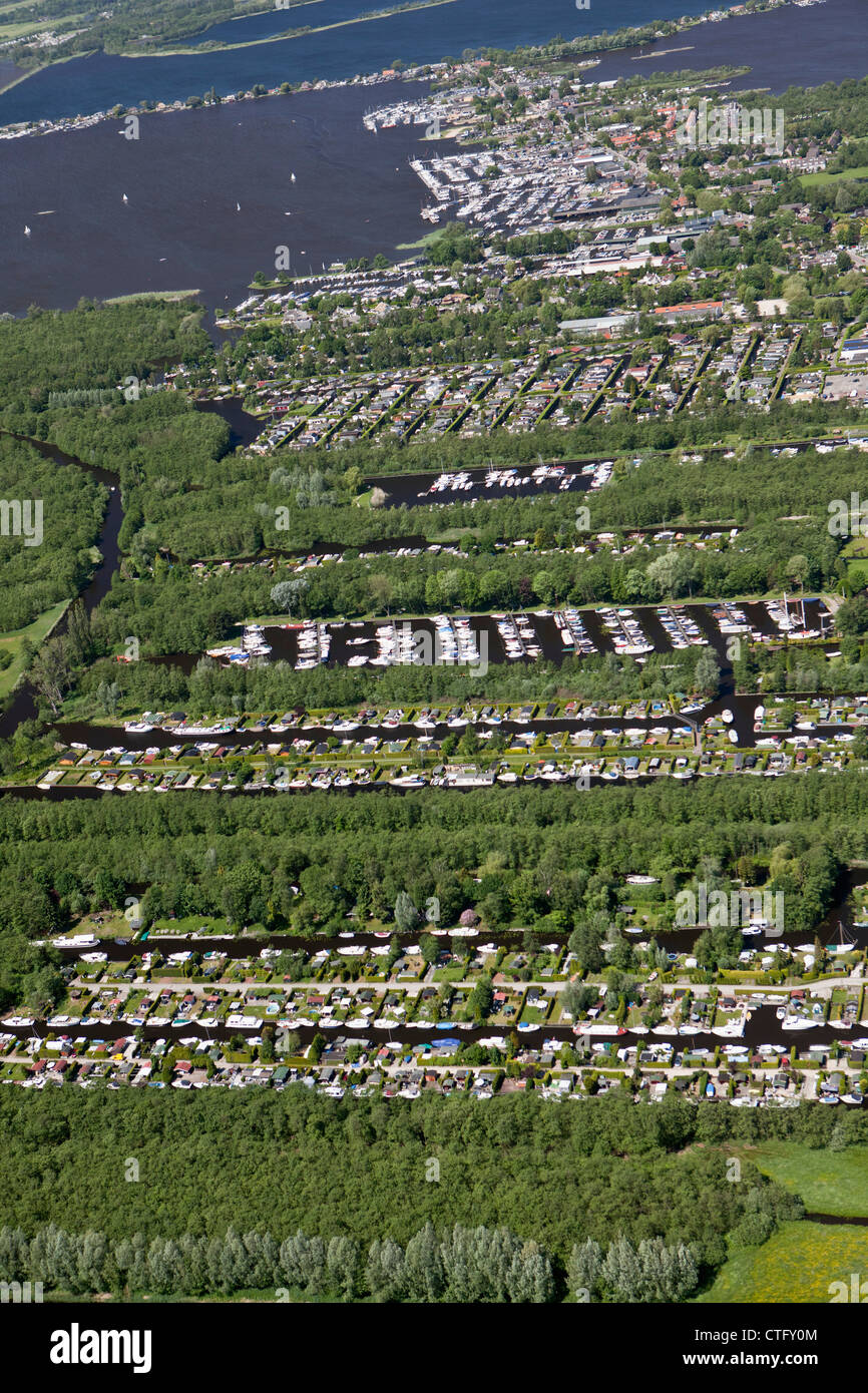 The Netherlands, Loosdrecht, Aerial. Holiday houses and boats near lake called Loosdrecht lakes. - Stock Image