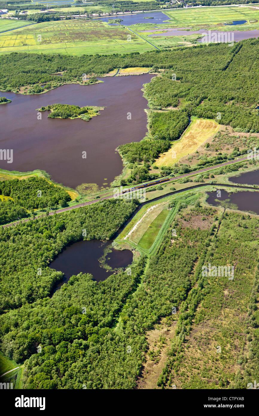 The Netherlands, Naarden, Lake called Naardermeer. Aerial. Train passing. - Stock Image