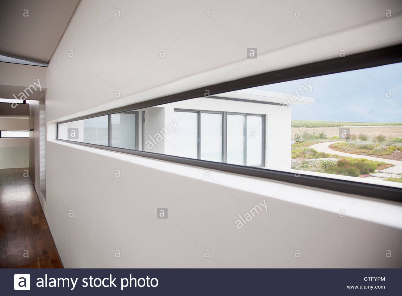View from long window in modern house - Stock Image