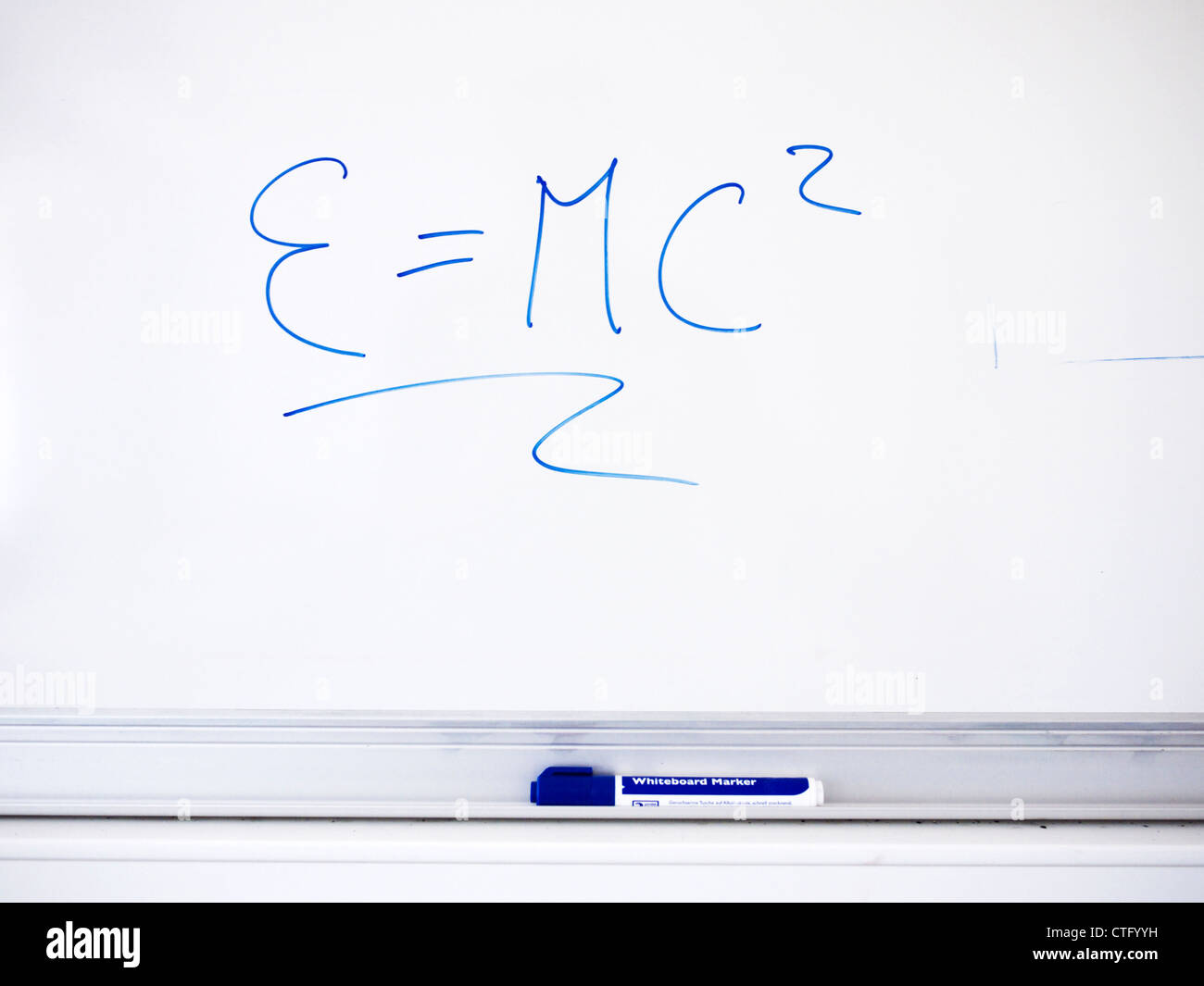 Whiteboard with theroy of relativity written upon - Stock Image