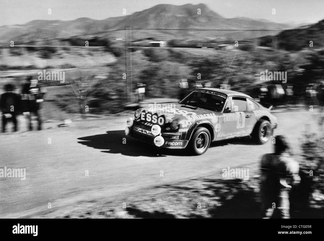 Porsche 911 rally cars on a special stage,competing in the 1982 Monte Carlo Rally - Stock Image