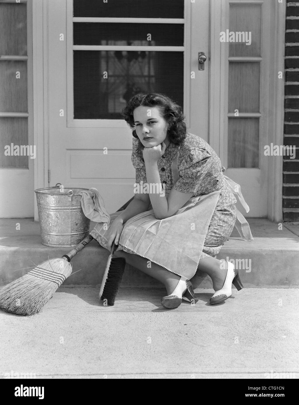 1930s 1940s woman housewife sitting on front door step surrounded by stock photo 49524853 alamy. Black Bedroom Furniture Sets. Home Design Ideas