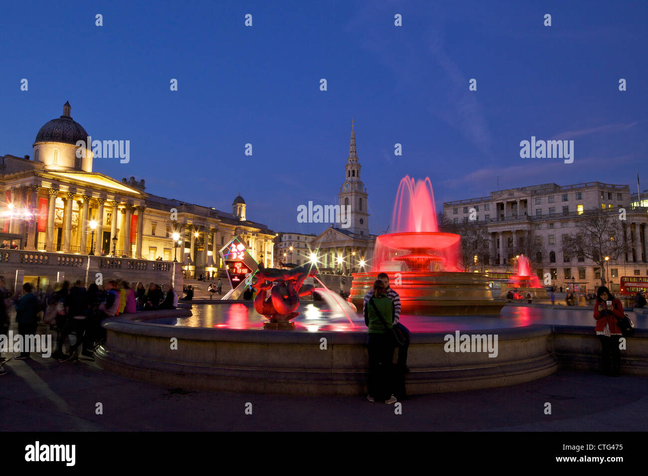 Trafalgar Square at dusk with St Martin in the Fields and the National Gallery, London, England, UK, United Kingdom - Stock Image