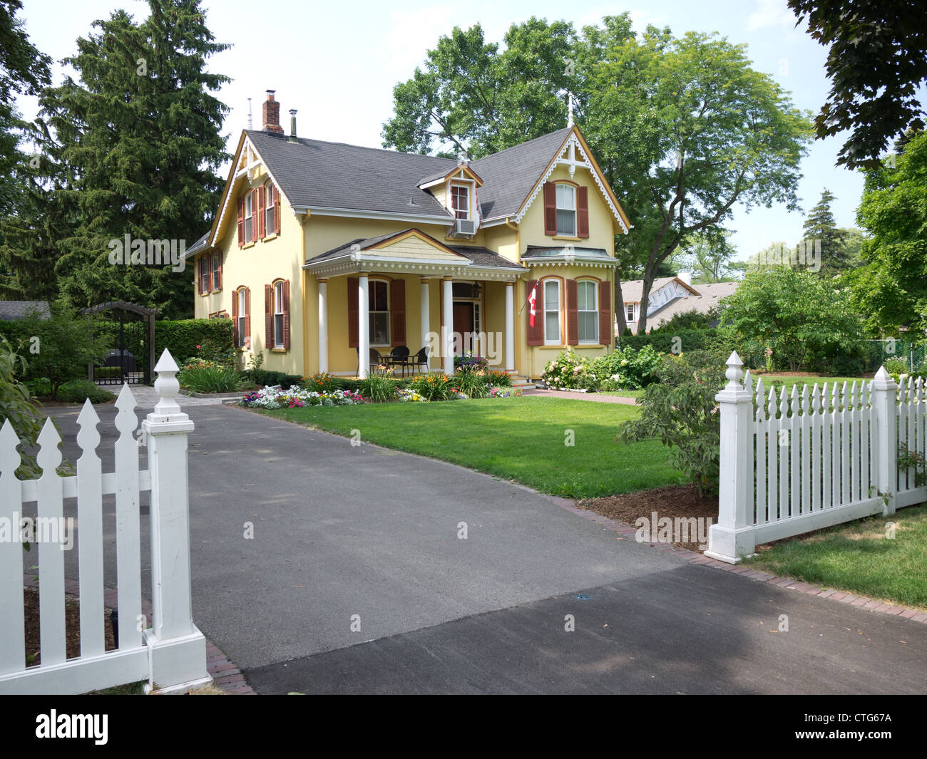Victorian style house home front yard - Stock Image