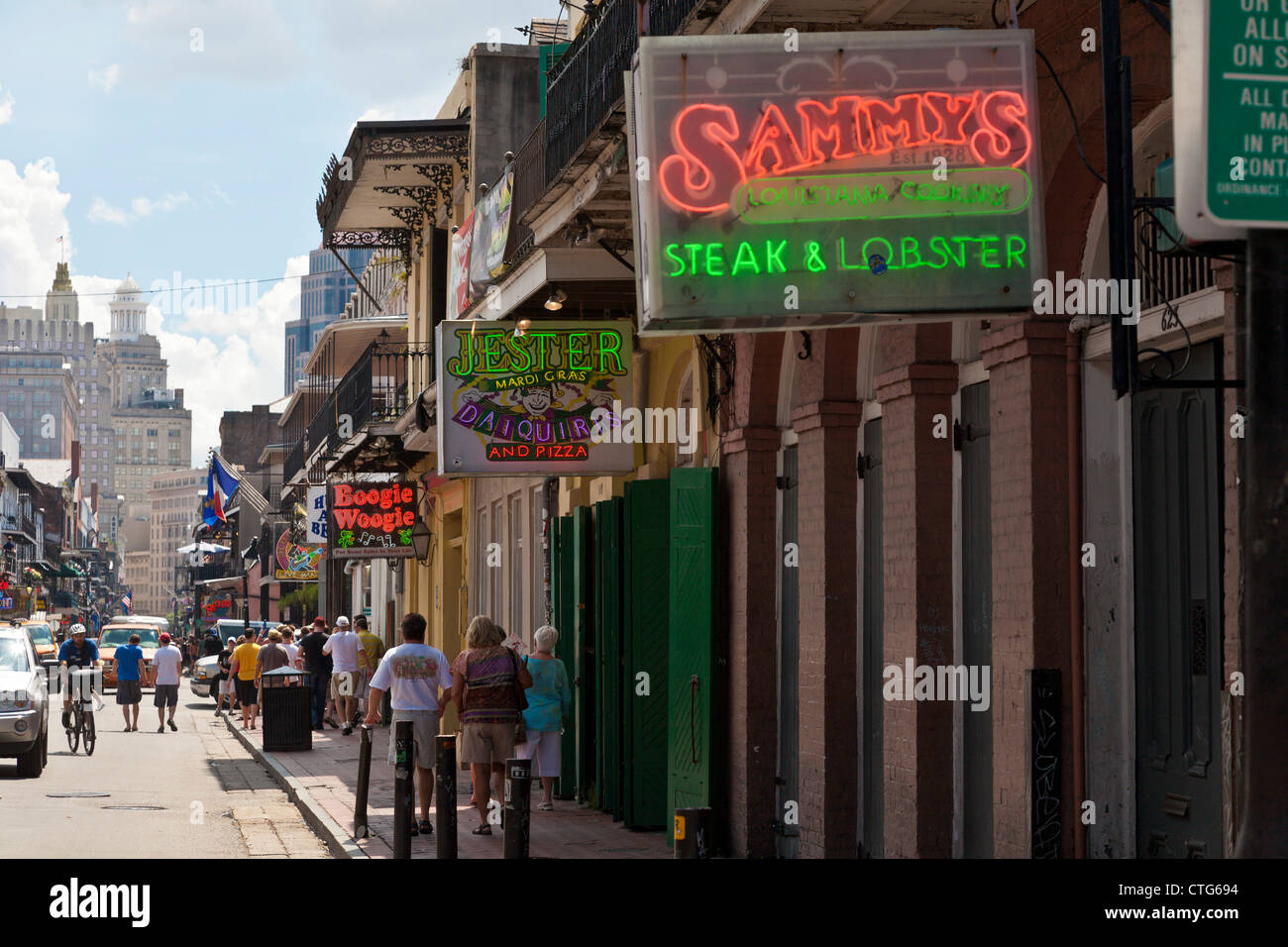 Neon Signs Advertise Restaurants And Bars Along Bourbon Street In