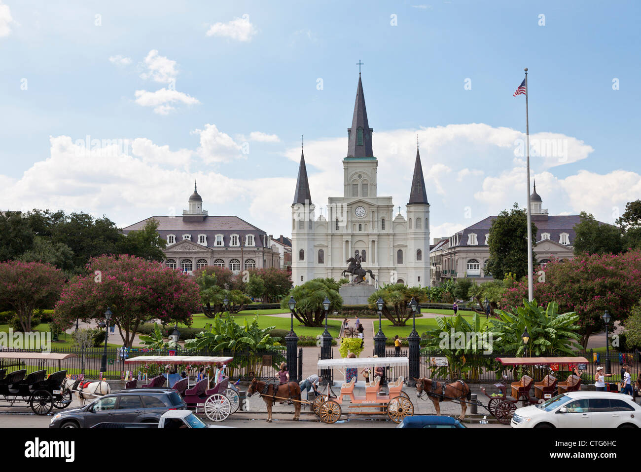 Horse and carriage vendors line up on Decatur Street in front of Jackson Square in the French Quarter of New Orleans, - Stock Image