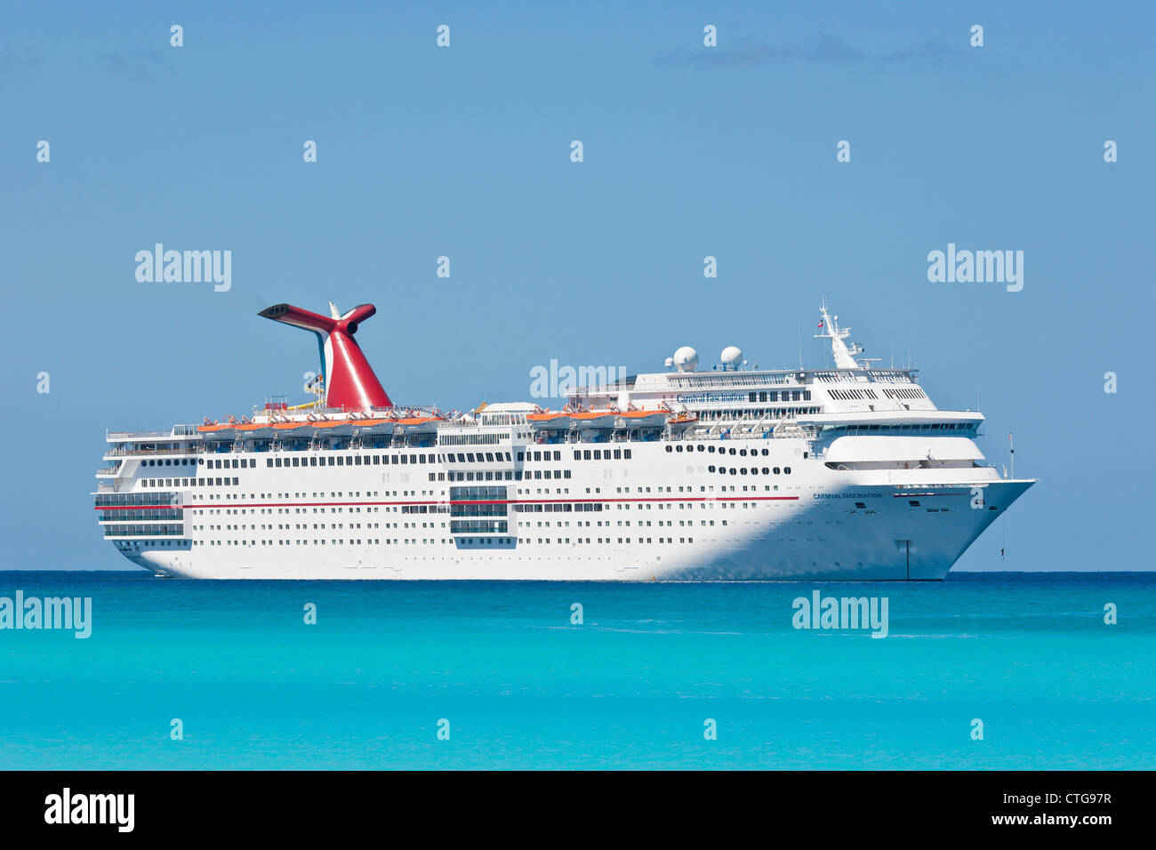 Carnival Fascination ship moored at Half Moon Cay, Bahamas - Stock Image