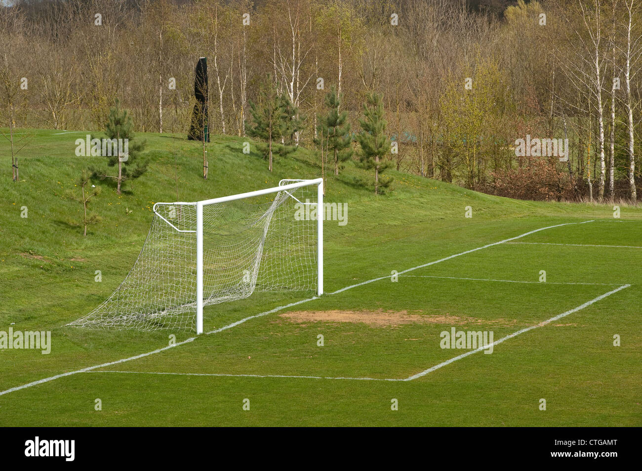 Goal posts on an empty football pitch in a park in England. - Stock Image
