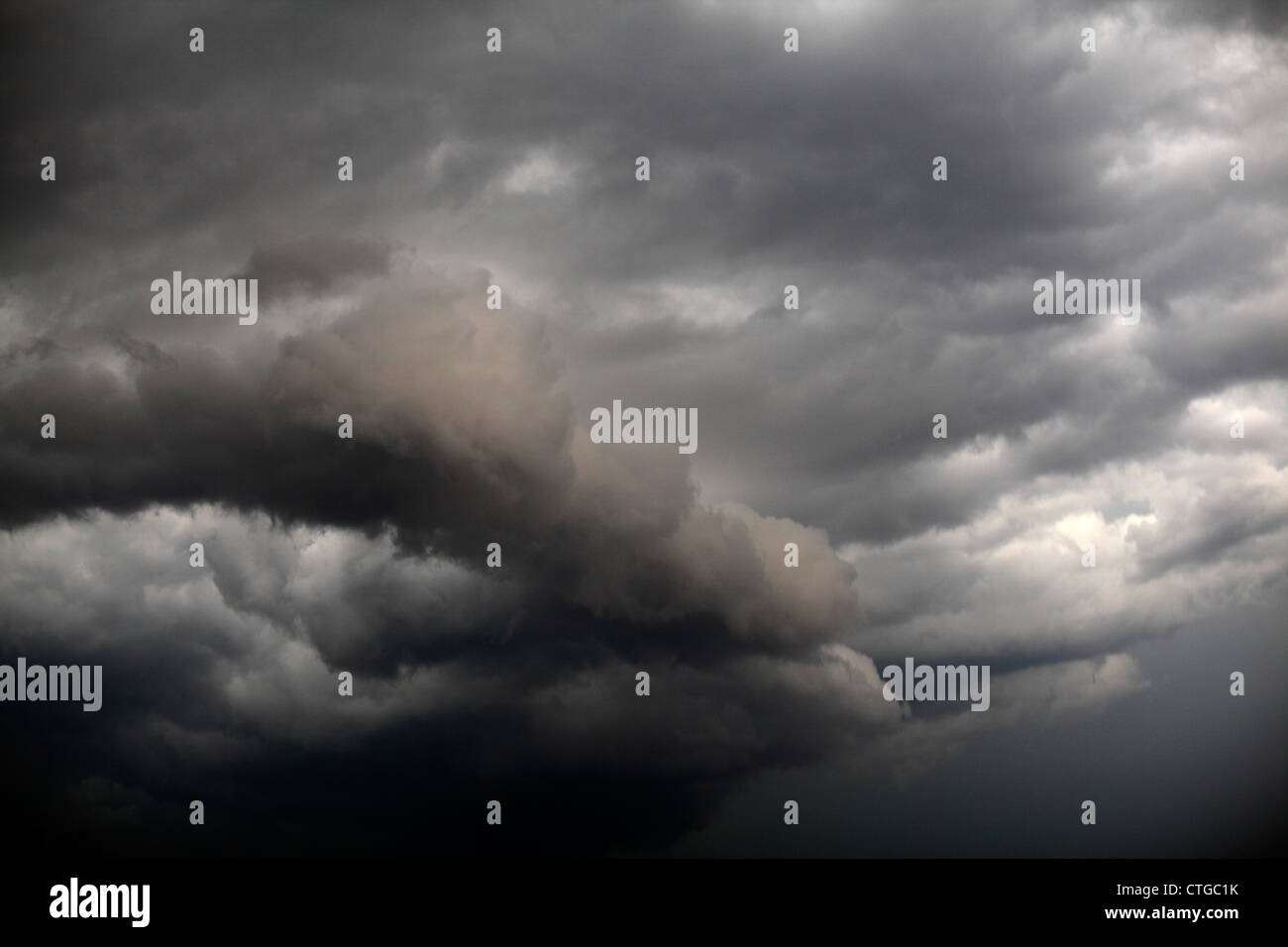 Squall line clouds, racing against each other in the sky. - Stock Image