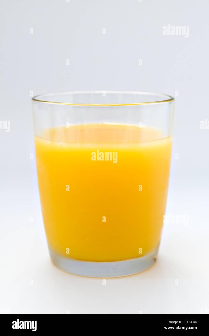 Glass of orange juice on white background - Stock Image