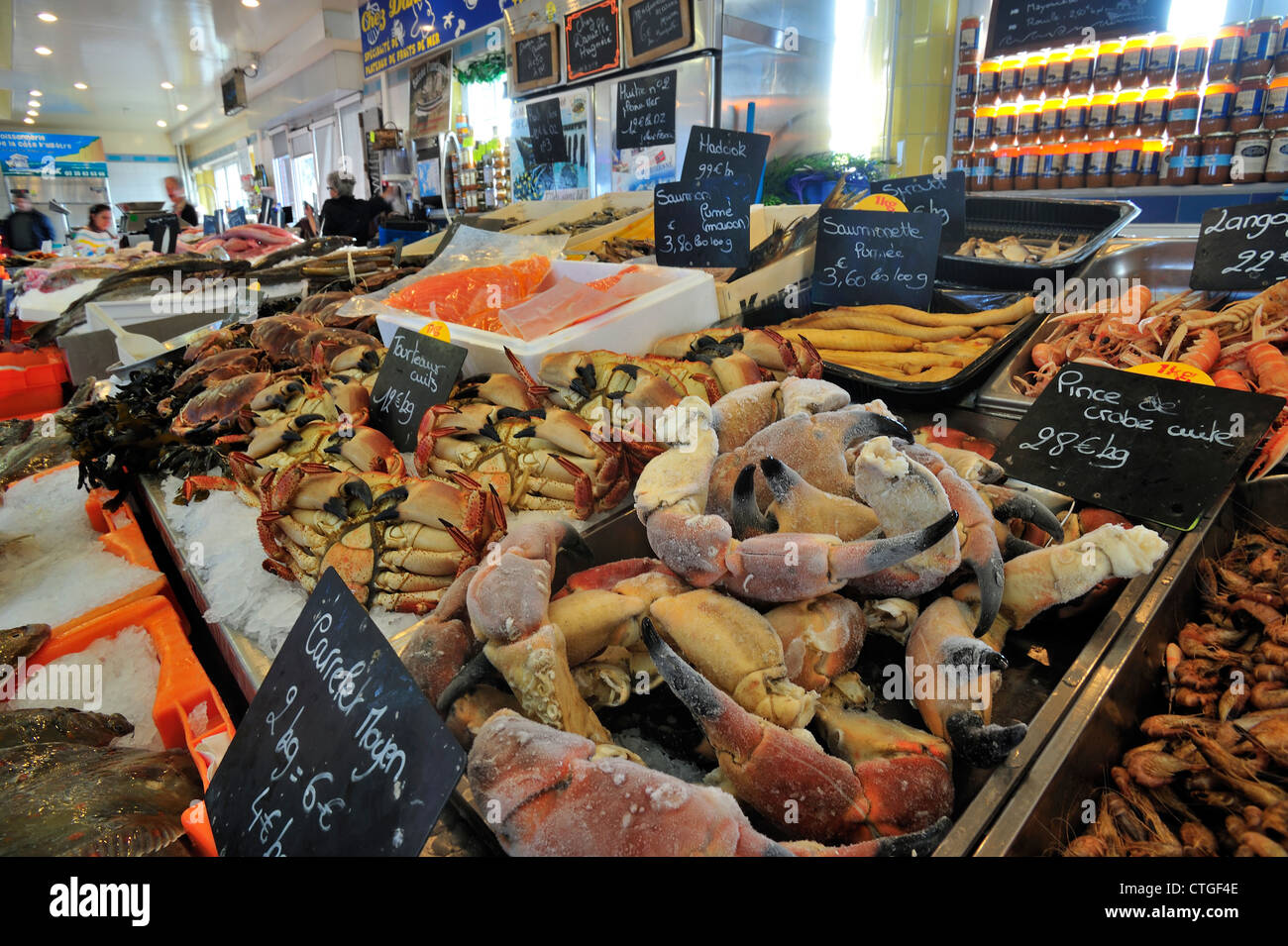Fresh crabs and seafood on display at indoor fish market for Seafood fish market