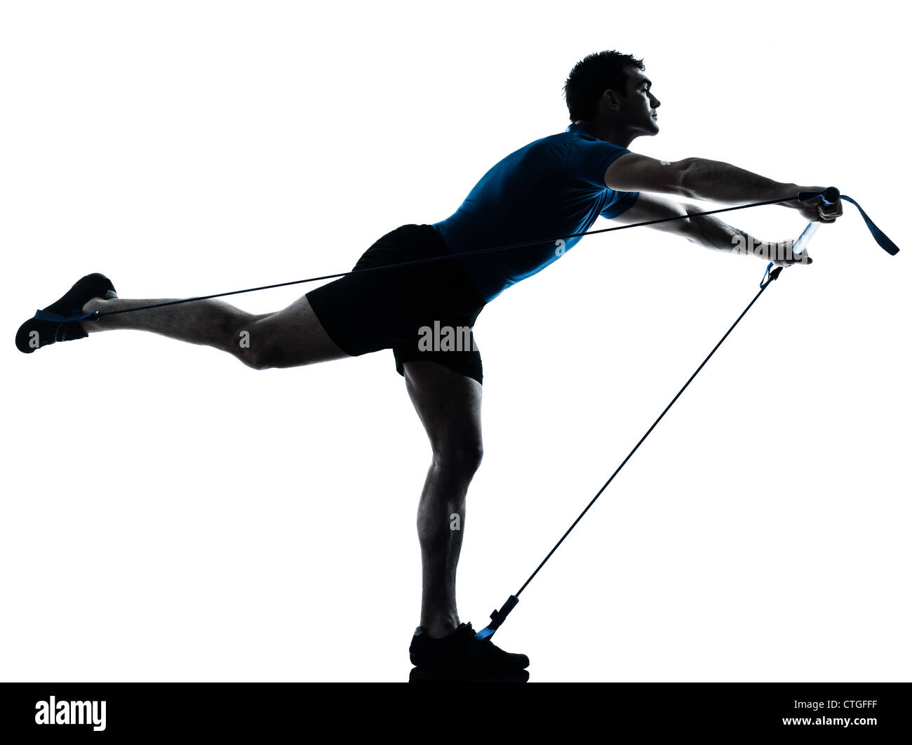 one caucasian man exercising gymstick workout fitness in silhouette studio  isolated on white background - Stock Image
