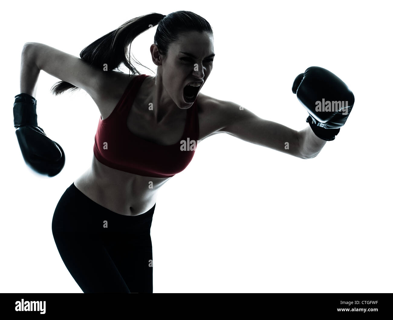 one caucasian woman boxing exercising in silhouette studio  isolated on white background - Stock Image