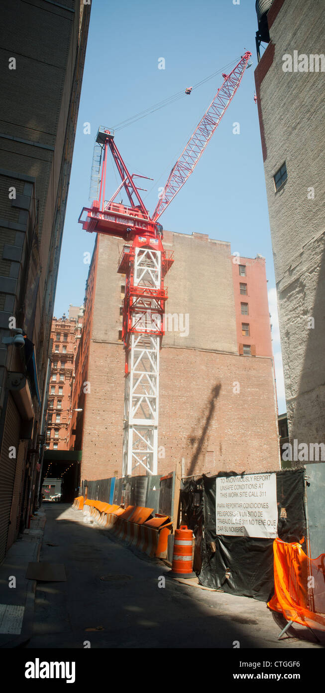 A construction crane at a development site in Lower Manhattan, seen on Sunday, July 22, 2012 (© Richard B. - Stock Image