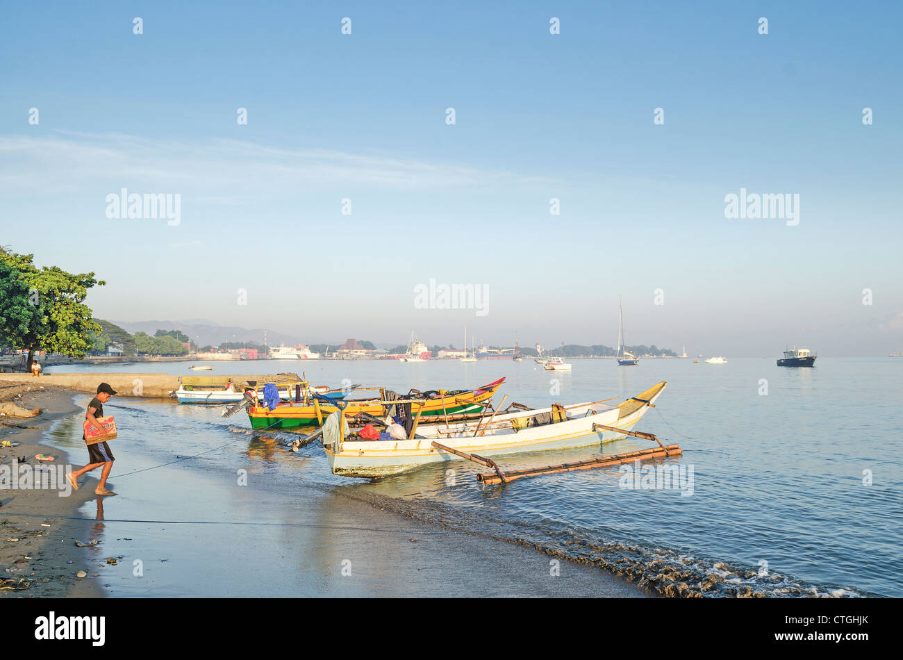 fishing boats on beach in dili east timor, timor leste Stock Photo