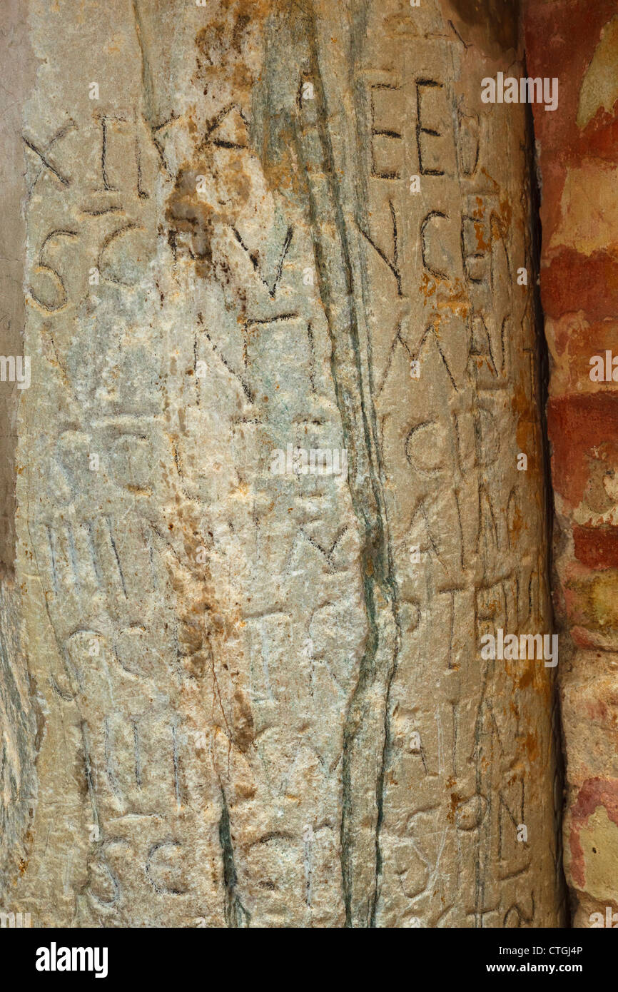 Carmona, Seville Province, Spain.  6th century Visigothic calendar carved into pillar in Orange Tree patio. - Stock Image