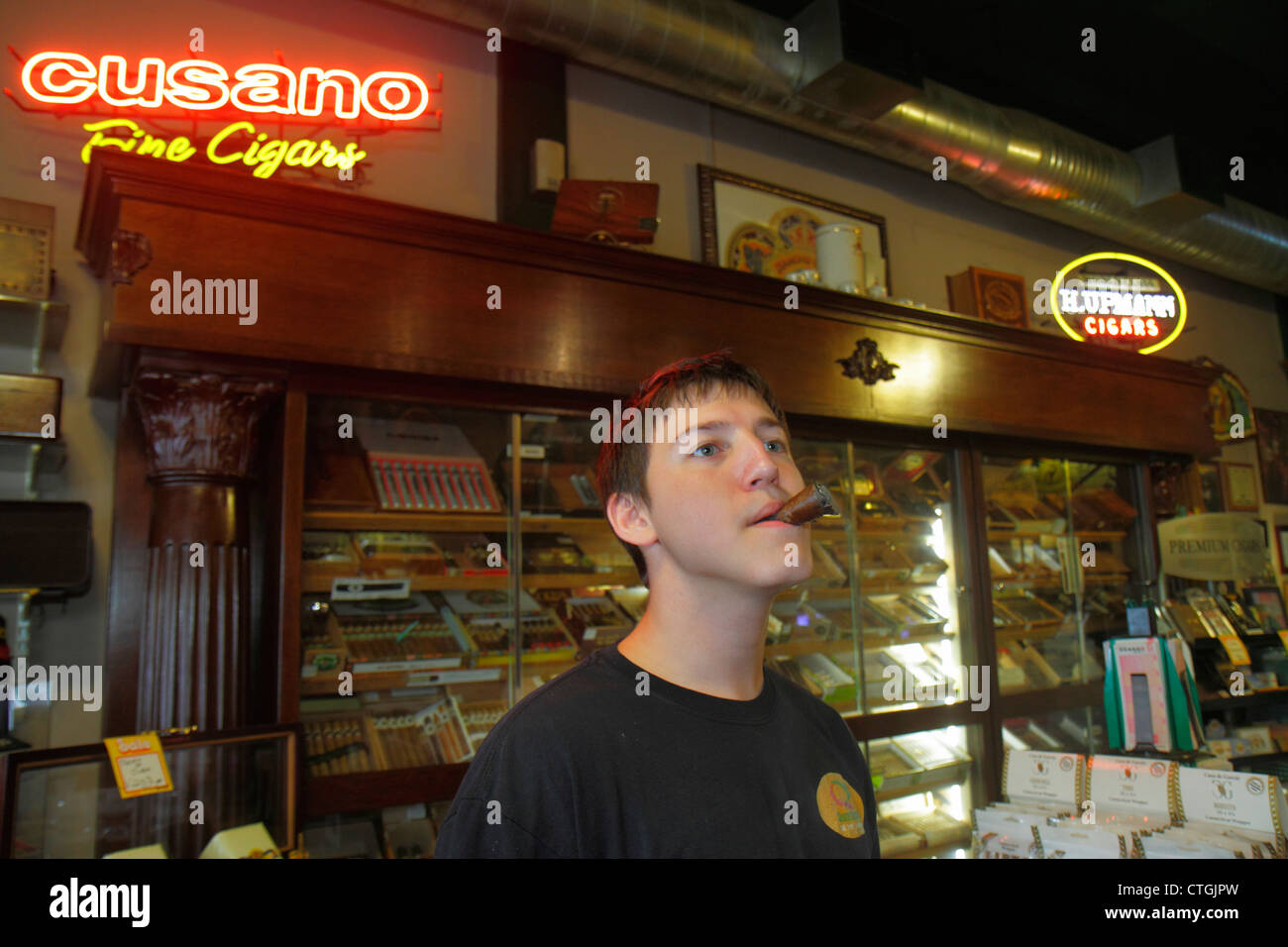Stuart Florida SW Osceola Street shopping business district Smokin Premiums cigar tobacco shop man young adult smoking Stock Photo